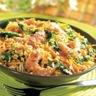 Crevettes rissolées et petits légumes avec couscous épices douces