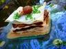 Millefeuille de joues de porc braisées aux châtaignes et au cidre sauce crémeuse au foie gras