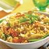 Wok de poulet aux noix de cajou avec légumes primeurs et couscous aux épices du monde