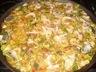 Paella au poulet, aux légumes et fruits de mer