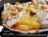 Pizza à l'ananas caramélisé, au poulet fumé et aux oignons