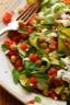 Pois chiches, courgettes grillées et fromage de chèvre en salade tiède