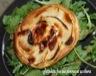 Tartelette fine aux pommes et au chevre roquette vinaigrette au miel