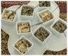 Deux verrines : rillettes de sardines et crème de tomates séchées aux olives