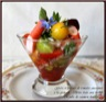 Gelée et tartare de tomates anciennes à la grenade, chèvre frais aux herbes, roulés de saumon fumé
