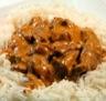 Plats de volailles: Dés de poulet sauce tomatée aux champignons