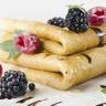 Aumônières de crêpes au chocolat Trésor de fruits frais Coulis de framboises