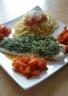 Cabillaud en croûte d'herbes poivrons grillés et pâte au coulis de tomates