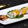 Carpaccio de saint-jacques marinées au citron vert mangue et feuilles de wasabi