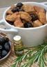 Compotée de noix de veau aux olives noires et au romarin