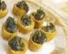 Coquetiers de pommes de terre aux escargots et aux deux herbes