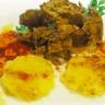 Effiloché de sanglier galettes de polenta et vinaigrette froide à la pulpe de cassis