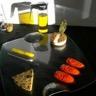 Gâteau au fromage de chèvre et mascarpone au curry graines de sesame caviar d'aubergine aux herb...