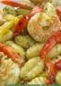 Gnocchis au pesto et crevettes sautées