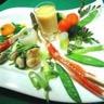 Légumes primeurs huile de carapaces langoustine royale joues de raies caramélisées et jaune do...