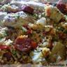 Paella au poulet poisson et chorizo