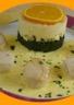 Poêlée de noix de St-Jacques à l'orange purée vanillée sur lit d'épinards
