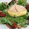 Pommes de terre au foie gras fondantes roquette et tomates confites