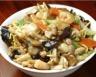 Poulet sauté aux légumes et champignons au wok