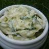 Rémoulade de courgettes au fromage de chèvre frais et aux fines herbes