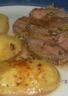 Rôti de porc entouré de pommes de terre
