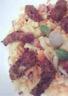 Salade d'escalope panée sur son nid de choux chinois et carottes rappées