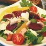 Salade de Gésiers de Canard maigre confits vinaigrette tiède aux agrumes et pignons de pins torr...