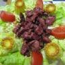 Salade de gésiers et faux cannelés lardons oignons
