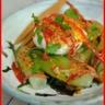 Salade tiède de chicorée Catalogne oeuf poché au piment d'Espelette et chorizo