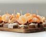Toasts de seigle aux crevettes et tomates séchées
