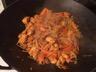 Wok de poulet curry aux ananas caramélisés