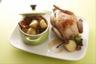 Caille farcie au foie gras fricassée de champignons et pommes grenaille en cocotte