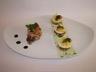 Caille rôtie au cognac et morilles et ses petits oeufs sur ses galettes de pomme de terre au gruyère et brisures de truffe coulis de persil plat
