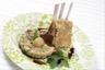 Carré d'agneau croûte de thym et citron confit mitonnée d'aubergines