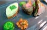 Côtes d'agneau rôties tortellini de chèvre calisson d'aubergine et tomate harissa douce de Frédéric Doucet