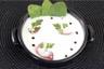 Crème de céleri-rave au magret fumé et oeuf de caille poché