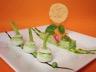 Déclinaison printanière autour des légumes : petits navets farcis à la purée de petits pois semoule de chou-fleur au pesto de pousses d'épinard filets de rouget Grondin grillés et sucette de parmesan