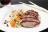 Filet de canard laqué au miel de soja et balsamique wok de légumes de saison