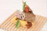 Gigotin d'agneau au chèvre et jambon de Parme croustillant de polenta aux tomates confites