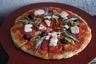 Pizza aux anchois - mozzarella et tomates fraîches