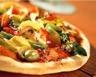 Pizza aux légumes et au jambon
