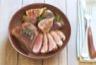 Salade de magret de canard aux figues et amandes